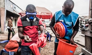 Health workers wear protective gear to mix water and chlorine in Goma on 31 July. A second person has the disease in the eastern city of Goma, a major transport hub in the DRC.