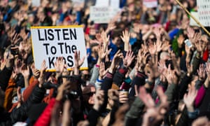 People demonstrate against gun violence after the Parkland school shooting.