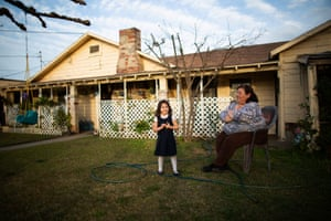Jovita Torres (right), who has lived in her house she rents in Tombstone Territory (an unincorporated working class neighborhood 20 minutes south east of Fresno) for 30 years, in her garden with her 3.5 year old granddaughter Alessandra California, February 21st, 2020.