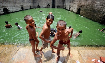 Indian children cool off on a hot day in Delhi