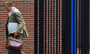 Former Dutch neurologist Ernst Jansen Steur arrives at court in Almelo, the Netherlands, November 2013.