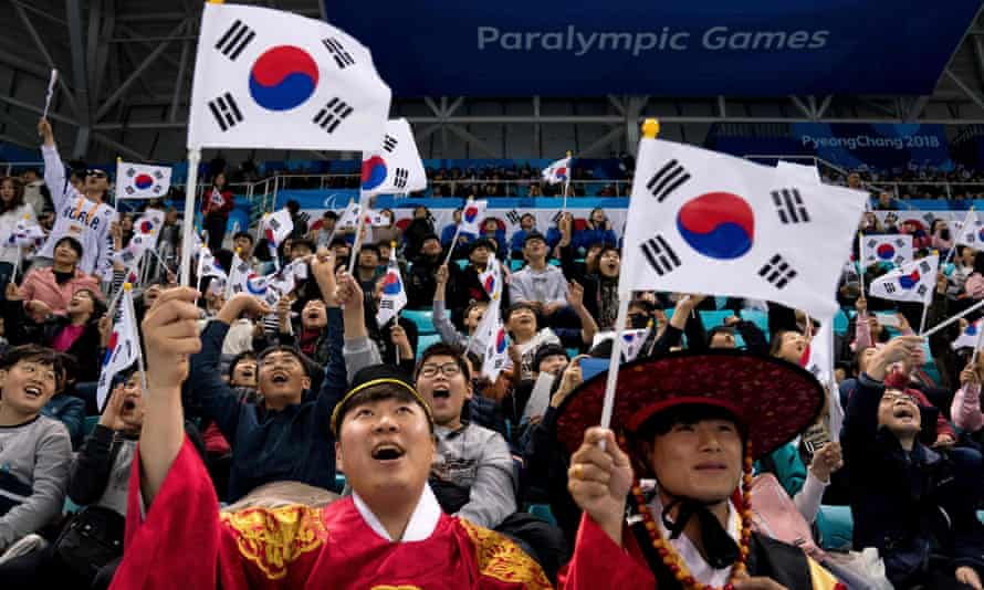 South Korea fans cheer their team on during the ice hockey preliminary round game between the US and South Korea during the Pyeongchang 2018 Winter Paralympic Games