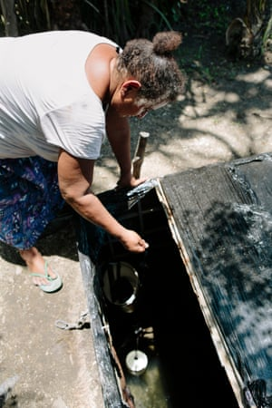 Elizabeth Ila, 53, draws water from her well in Papua New Guinea, Port Moresby