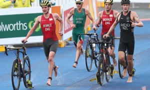 Alistair Brownlee (left) and his brother Jonny leave the water and grab their bikes for the second stage of the triathlon. They finished 10th and seventh respectively.