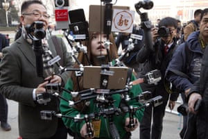 Beijing, China: A journalist outside the Great Hall