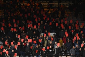 Port Vale fans hold up red cards in protest at owner Norman Smurthwaite.
