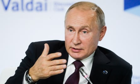Russia's President Vladimir Putin attends a session titled The Dawn of the East and the World Political Order in Sochi