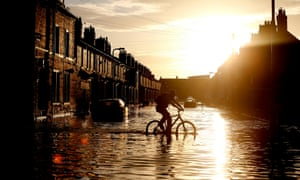 A cyclist through floodwater in Carlisle.