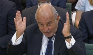 Philip Green with his hands in the air before parliament's business select committee