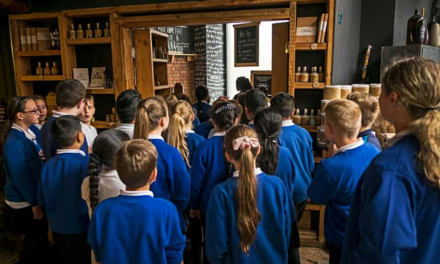 Children enter Grimm & Co's apothecary