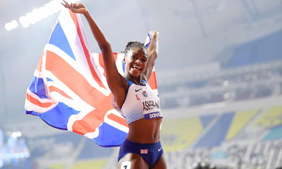 Dina Asher-Smith celebrates after winning gold in the 200m of 17th IAAF World Athletics Championships in Doha, 2019.