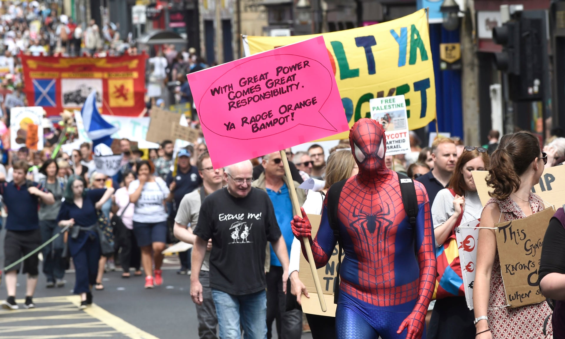 Scottish Spider-Man makes his point as thousands march in Edinburgh against Donald Trump's visit. — Photograph: Lesley Martin/Press Association.