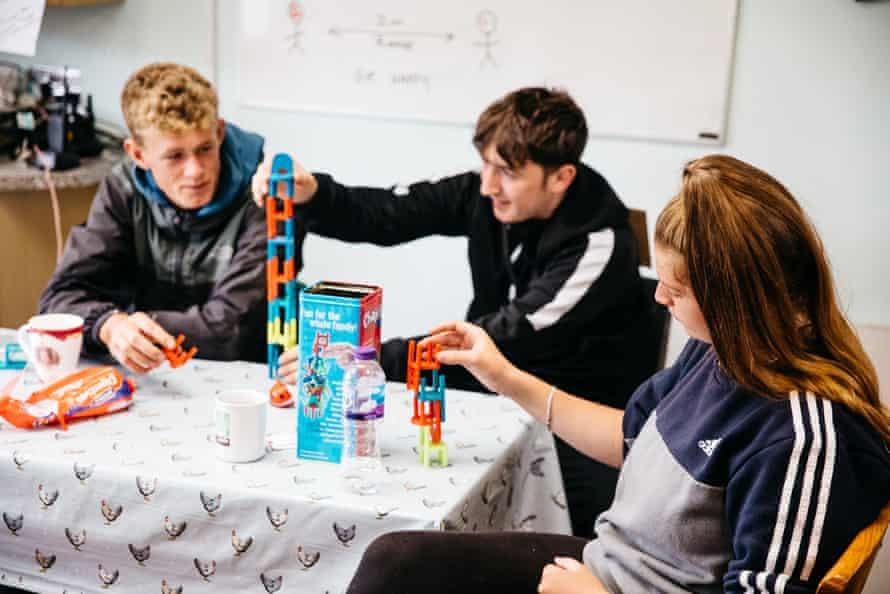 Jordan Ellis (left) Jaryn Taylor (centre) and Maryanne play games on a tea break.