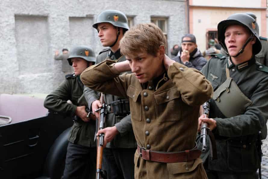 Mateusz Więcławek as Grzegorz Tomaszeski, brother of Kasia Tomaszeski, in World on Fire.