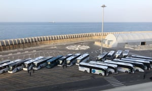 Buses parked at the Civitavecchia port ready to transport Australian Costa Victoria passengers to Rome