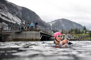 An athlete trains in the Hardangerfjord before the Isklar Norseman extreme triathlon in Norway on Sunday