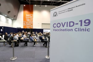 Members of the public wait to receive their Covid-19 vaccination at a mass vaccination clinic at Perth Convention and Exhibition Centre on 16 August.