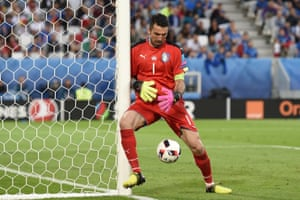 Gianluigi Buffon fumbles a deflected cross.