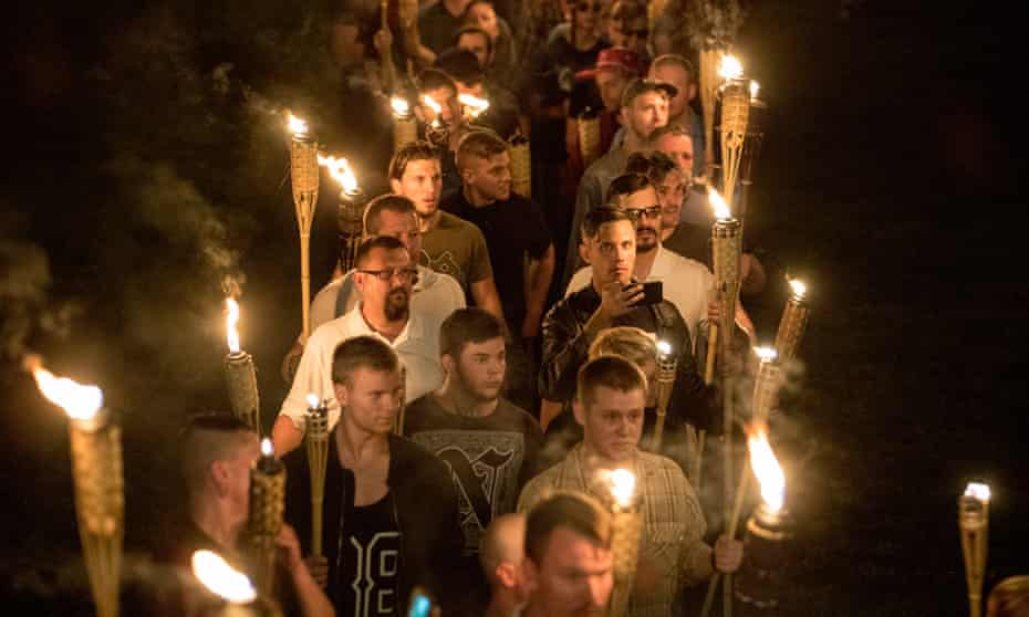 White nationalists and torch-bearing white supremacists march through the University of Virginia campus in Charlottesville in August 2017.
