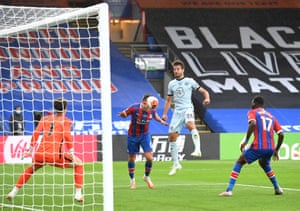 Scott Dann of Crystal Palace heads the ball that is saved by Kepa Arrizabalaga of Chelsea.