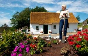 Gallagher in her garden