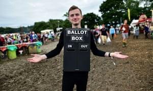 Patrick Irish, from Gloucestershire, dresses as a ballot box at Glastonbury.