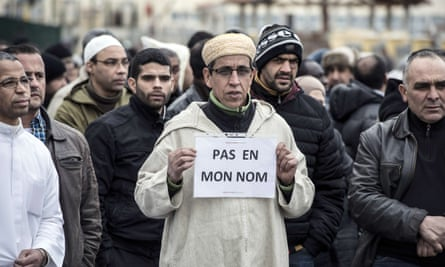A Muslim man holds a placard reading 'not in my name' after the attacks on Charlie Hebdo in Paris, January 2015.