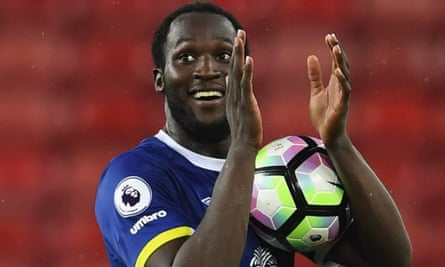 Romelu Lukaku walks off with the ball after his hat-trick.