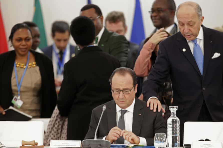 French president Francois Hollande, centre, with foreign minister Laurent Fabius at the COP21 conference in Le Bourget, Paris.