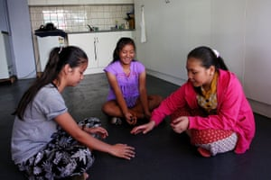 Bway Ku Gay, centre, plays with family