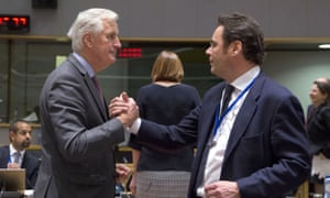 Michel Barnier, left, speaks with Spain's secretary of state for the European Union, Jorge Toledo Albinana, during a meeting of EU ministers in Brussels.