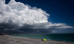 A beachgoer during a gathering storm in Antibes, southern France