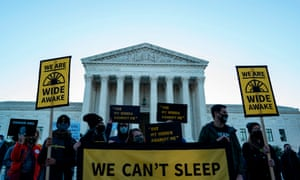 Protesters outside the supreme court on Monday. Ginsburg is expected to lie in state at the court before a funeral at Arlington National Cemetery.