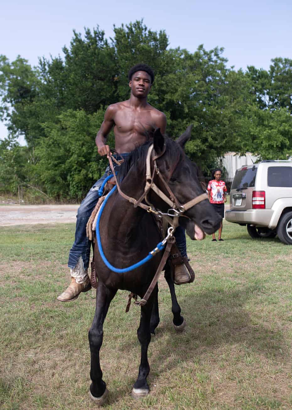 Blay Jay sits on his horse at the trail ride before the activities start.