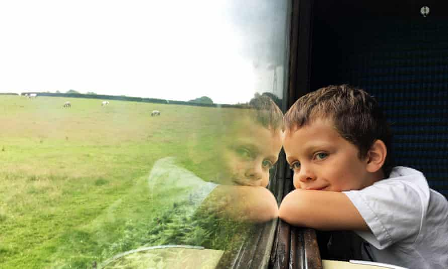 A child looks out of the carriage window on the Bodmin and Wenford Railway in Cornwall, UK.