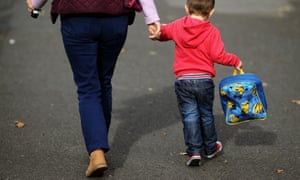 A child and parent walking to school