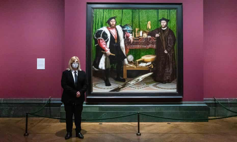 Masked and ready … a National Gallery staff member with Holbein's The Ambassadors.