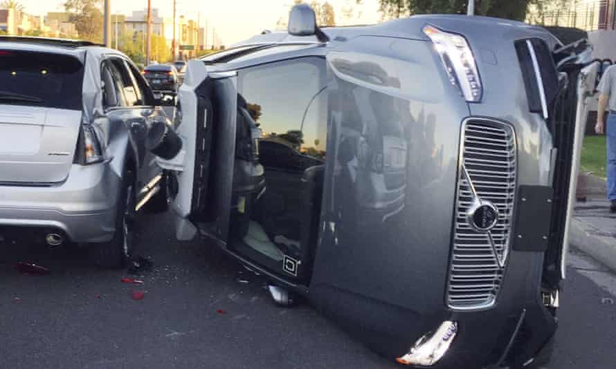 An Uber self-driving SUV that flipped on its side in a collision in Tempe, Ariz.