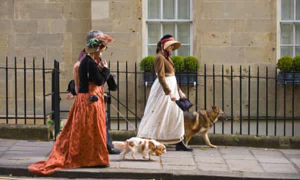 Two women in Regency costume walking dogs through Bath city centre during the 2012 Jane Austen FestivalCXBBGY Two women in Regency costume walking dogs through Bath city centre during the 2012 Jane Austen Festival
