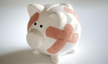 A piggybank with Band Aids