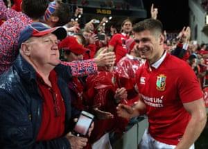The Lions' Owen Farrell greets fans.