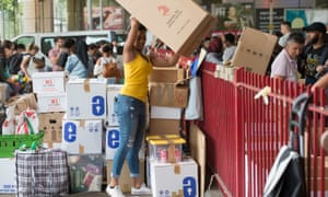 Volunteers organise boxes of donations after the Grenfell Tower fire.