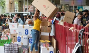 Volunteers organise boxes of donations near Grenfell Tower