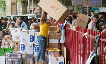 Volunteers organise boxes of donations following the fire at Grenfell Tower in west London.