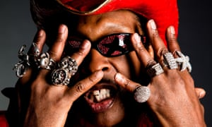 Gamin' on ya! Bootsy Collins with lots of rings, starry shades and a red cowboy hat.