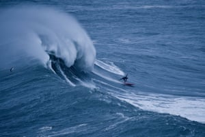A surfer rides a wave during a big-wave surfing session