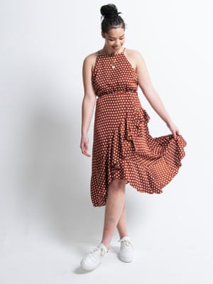 Model wears terracotta midi dress, £18.75, boohoo.com. Trainers, £139, whistles.com. Necklace, model's own.