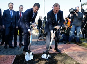 MIke Baird and the former prime minister Tony Abbott mark the early construction of the Westconnex stage two in Beverly Hills, Sydney, in July 2015