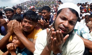 Rohingya refugees in Bangladesh take part in prayers to mark the second anniversary of their exodus from Myanmar