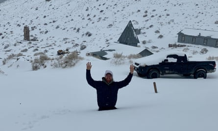 Brent Underwood, pictured up to his waist in snow, is the only living inhabitant of Cerro Gordo, California.